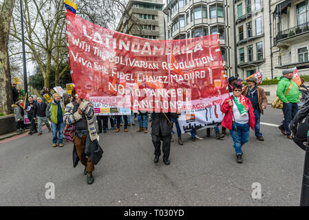 London, UK. 16th March 2019.  Latino Americans support the Bolivarian Revolution in the march by thousands through London on UN Anti-Racism day to say 'No to Racism, No to Fascism' and that 'Refugees Are Welcome Here', to show solidarity with the victims of racist attacks including yesterdays Christchurch mosque attack and to oppose Islamophobic hate crimes and racist policies in the UK and elsewhere. The marchers met in Park Lane where there were a number of speeches before marching to a rally in Whitehall. Marches took place in other cities around the world including Glasgow and Cardiff. Pet - Stock Image