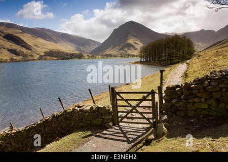 UK, Cumbria, Lake District, Buttermere, gate in path at end of Burtness Wood - Stock Image