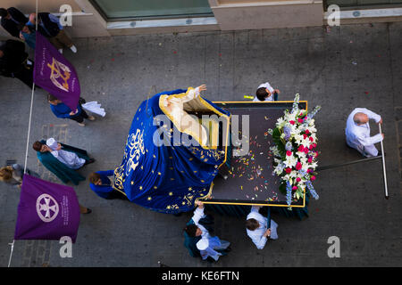 The statues and thrones of Jesus and Mary being taken away after Easter Sunday Resurrection Procession. - Stock Image