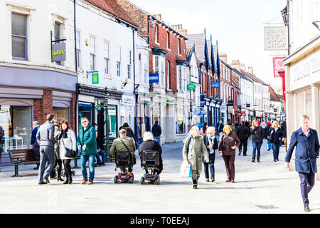 Beverley town centre, Beverley high street, center, shops, shoppers, stores outside main street shopping area Beverley Yorkshire UK England - Stock Image