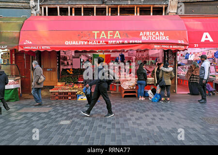 TAFA African butcher store and stalls at Brixton street market Electric Avenue Brixton South London SW9 England UK  KATHY DEWITT - Stock Image