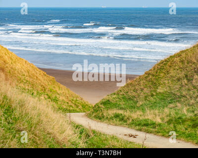 A steep bridle way for horse riders access down the cliff between Marske and Saltburn on the North Yorkshire Coast - Stock Image