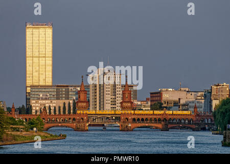 River Spree, Oberbaum bridge,  Office buildings, Aliianz tower, Treptowers, Monecule Man, Berlin , Germany - Stock Image