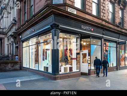 Window display and entrance of the swatch fashion Swiss watches shop in Buchanan Street, Glasgow, Scotland. - Stock Image