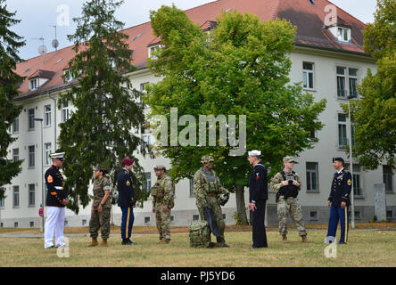 Members from units left to right, Marine Forces Europe and Africa, 10th Special Forces Group (Airborne), Naval Special Warfare Unit and 554th Military Police Company, pose for a photo that will be used for a booklet called History of Panzer Kaserne 1938-2018. (US Army photo by Visual Information Specialist Rey Ramon) - Stock Image