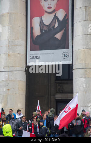 Warsaw, Poland, 11 November 2018: celebrations of Polish Independence Day. People with Polish flags in front of theater building - Stock Image