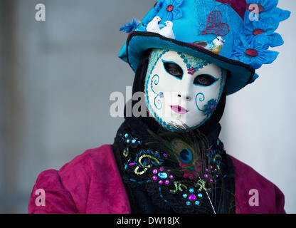 Venice, Italy. 25th Feb, 2014. A masked and costumed Carnivale performer who has small birds nestled on her hat. Venice Carnivale - Tuesday 25th February. Credit:  MeonStock/Alamy Live News - Stock Image