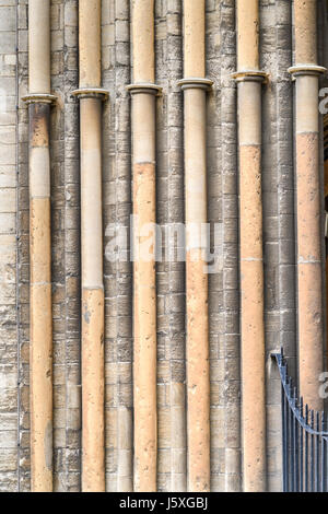 Slender stone pillars at the west facade of the medieval christian cathedral at Peterborough, England. - Stock Image