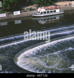 Boat at Pulteney Bridge and the Weir Bath Wiltshire UK - Stock Image
