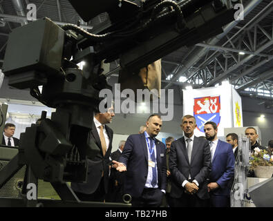 Brno, Czech Republic. 29th May, 2019. Czech PM Andrej Babis (centre) visits the international trade fair of defence and security technology IDET, trade fair of security technology and services ISET and trade fair of firefighting technology PYROS in Brno, Czech Republic, May 29, 2019. Credit: Igor Zehl/CTK Photo/Alamy Live News - Stock Image