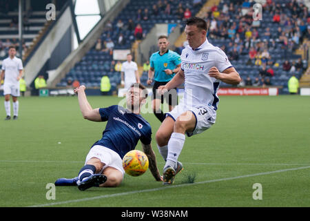 Starks Park, Kirkcaldy, UK. 13th July, 2019. Scottish League Cup football, Raith Rovers versus Dundee; Brad Spencer of Raith Rovers challenges for the ball with Jordan Marshall of Dundee Credit: Action Plus Sports/Alamy Live News - Stock Image