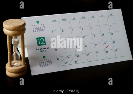 Calendar marked on December 21st 2012 the Mayan Judgment Day with a sand timer - Stock Image