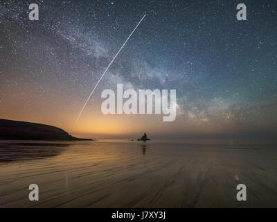 Above Broad Haven beach in Pembrokeshire, Wales. The International Space Station (ISS) is captured travelling across - Stock Image