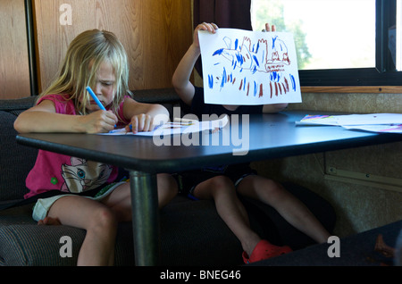 Brother and Sister Drawing in a Campervan RV, Texas, U.S.A - Stock Image