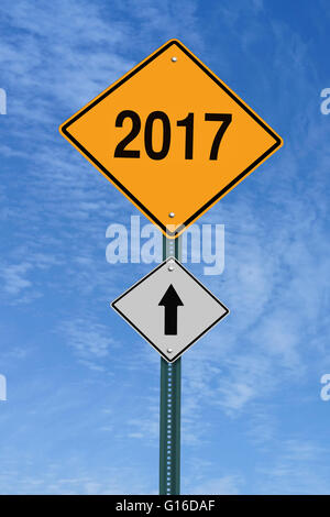 2017 ahead road sign over blue sky with clouds - Stock Image
