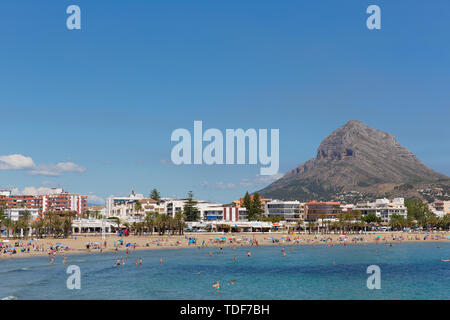 Xabia Spain Playa del Arenal beach in summer with blue sky and mountain - Stock Image