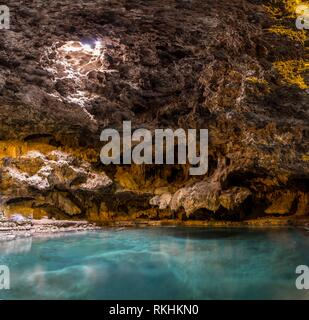 Cave with a geothermal spring, Cave and Basin National Historic Site, Banff National Park, Alberta, Canada - Stock Image