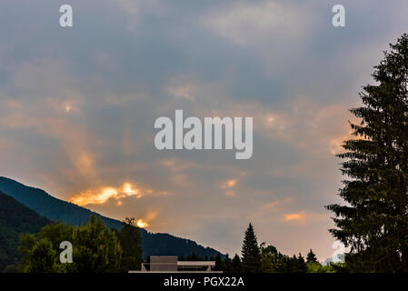 Sunrise over the mountains at Levico Terme, Trentino, Italy - Stock Image