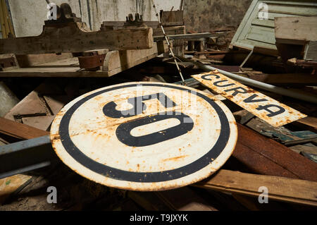 Old speed warning signal thrown in neglected facilities at Canfranc International railway station (Canfranc, Pyrenees, Huesca, Aragon, Spain) - Stock Image