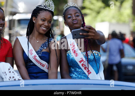 Montreal, Canada. 7/7/2018. Miss Teen takes a selfie with Miss Montreal Carifiesta  before the Carifiesta parade in downtown Montreal. Credit: richard prudhomme/Alamy Live News - Stock Image