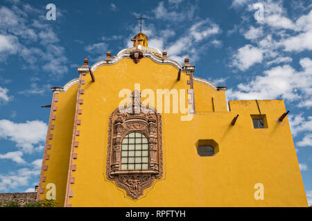 The facade of the Aranzazu Chapel and San Francisco Convent in the Plaza de Aranzazu in the state capital of San Luis Potosi, Mexico. The chapel and convent was built between 1749 and 1760 and features Churrigueresque details and tiled domes. - Stock Image