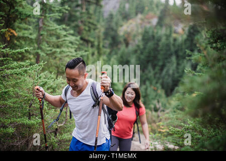 Couple hiking in woods - Stock Image