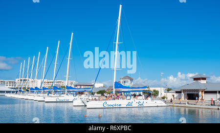 A group of tourists prepare to go on an outing from Varadero Cuba. - Stock Image