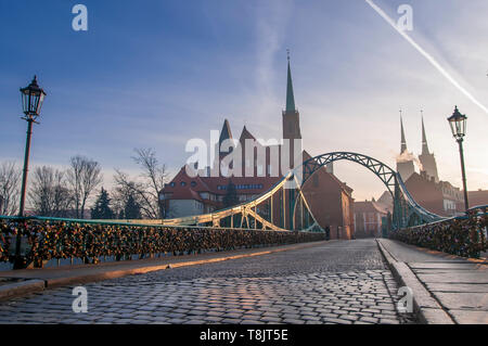 Tumski Bridge and Cathedral of St. John the Baptist twin towers on Ostrow Tumski. Wroclaw, Poland 2019 - Stock Image