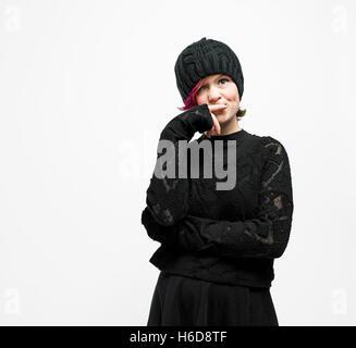 Teen pixie girl posing in studio. - Stock Image