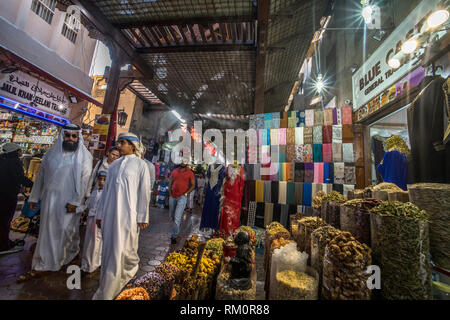 Shafts of light beam through rafters and lighten the incense laden streets of a Dubai Souk. - Stock Image