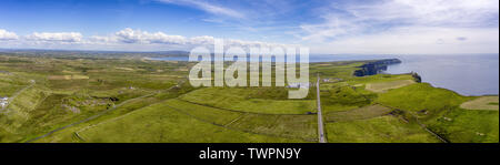 Cliffs of Moher in County Clare, Ireland. Beautiful Irish Countryside Landscape on the Wild Atlantic Way route, geopark geotourism drive. - Stock Image