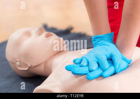 First Aid Training. Cardiopulmonary resuscitation. First aid course on cpr dummy. - Stock Image