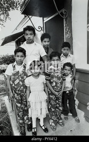 Salvadorian children in the United States illegally in 1983.  Children standing on the front porch of a safe house in Los Angeles, California.  The family fled the Salvadorian Civil War and entered the United States illegally with the assistance of an American church that gave them sanctuary. - Stock Image