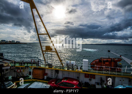 The car ferry from Armadale on the Isle of Skye approaches Mallaig Harbour on the Scottish mainland. - Stock Image