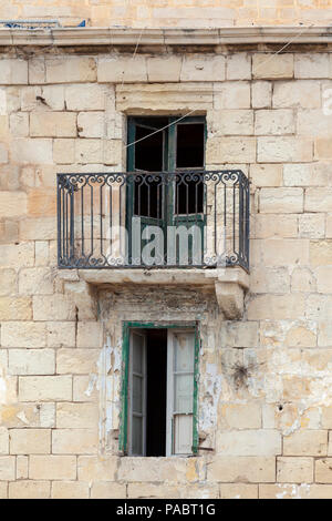 Old building in Malta with balcony - Stock Image
