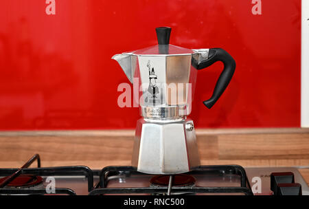 Classic design Bialetti coffee pot on cooker - Stock Image