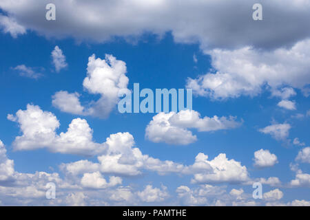 Cumulus clouds building before summer storm - France. - Stock Image