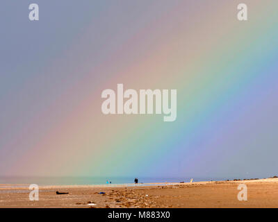 Formby, Merseyside, UK. 15th March 2018. Weather. Rainbow at the beach at Formby Merseyside. Credit: Alan Edwards/Alamy - Stock Image