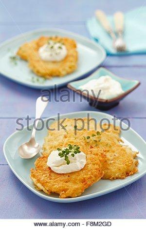Potato cakes with cream cheese - Stock Image