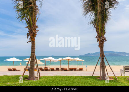 The Nha Trang Beach on a sunny day, the popular tourist destination in Vietnam - Stock Image