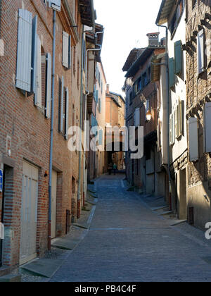 Steep narrow street leading to the cathedral, Albi, France - Stock Image