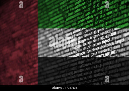 United Arab Emirates flag  is depicted on the screen with the program code. The concept of modern technology and site development. - Stock Image