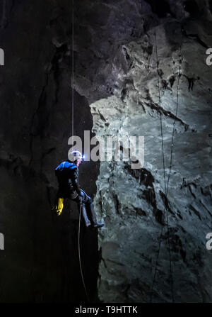 A potholer abseils into Gaping Gill, the largest cavern in Britain, situated in Yorkshire Dales National Park, ahead of its opening the public next weekend. - Stock Image