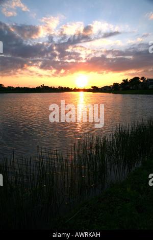 Sunset over lake, Port St. Lucie, FL, USA - Stock Image