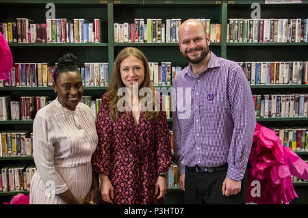 Chelsea Clinton poses with tth Mayor and Deputy Mayor of Hackney in the library at the 2018 Stoke Newington Literary Festival in Hackney, East London - Stock Image