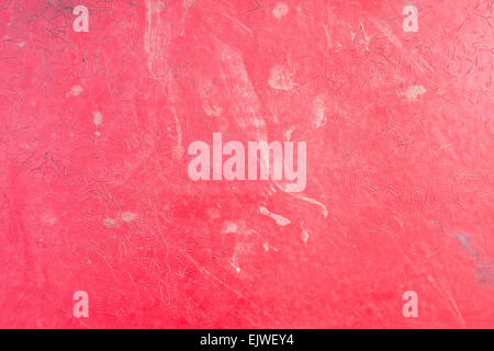 A messy red plastic surface as an abstract image - Stock Image