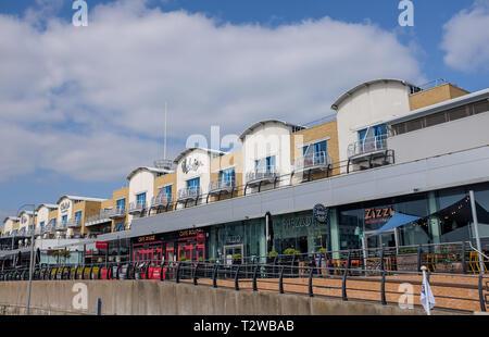 Brighton Marina Views UK - The Malmaison hotel above restaurants on the boardwalk - Stock Image