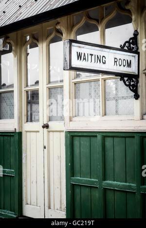 a waiting room in an old train station - Stock Image
