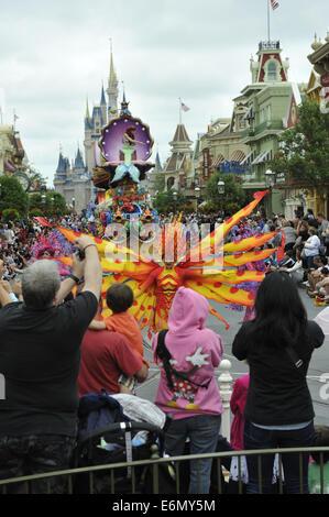 Orange and yellow dressed performer at Magic Kingdom Park, Walt Disney World, Orlando, Florida - Stock Image
