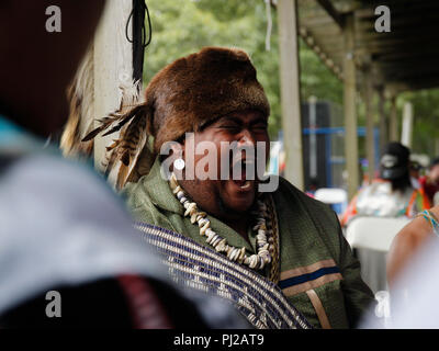 Southhampton, United States of America. 03rd, Sep 2018. A Native American singing with the group before the presentation to the ceremony 72nd annual Shinnecock Indian Powwow over the Labour Day weekend in Southampton Long Island New York in Southhampton, United States of America, 03 September 2018. (PHOTO) Alejandro Sala/Alamy News - Stock Image